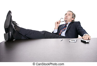 Mature businessman working, isolated over white background