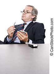 Mature Businessman working with PDA, isolated in white
