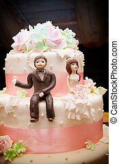 Wedding cake topper - A close up picture of a wedding cake...
