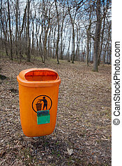 Dustbin along the path, orange color