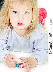 nice toddler girl looking in camera over white