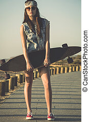 Skater Girl - Beautiful and fashion young woman posing with...