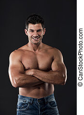 Muscular man - Portrait of a muscular man posing without a...