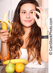 Vegetables versus Supplement - A young woman holding a...