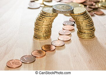 Bridge of coins - Bridge build out of euro coins with cents...