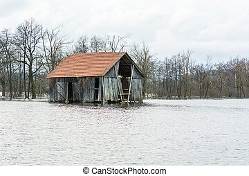 Barn surrounded with water after spring thaw