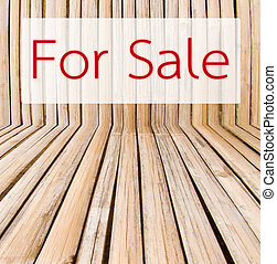 Sale tag on wooden background.
