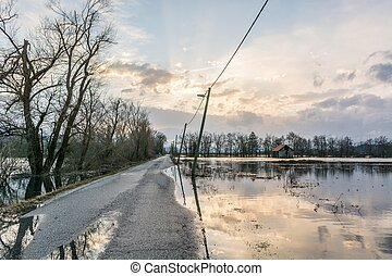 Flooded road - Road flooded after spring thaw with sun...