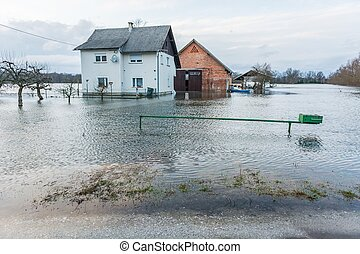 House surrounded with water because of spring thaw