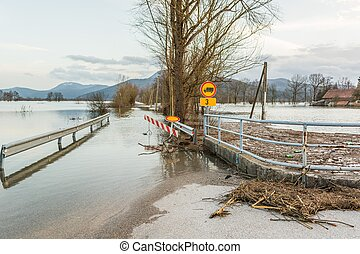 Roadblock beacouse of the floods - Roadblock placed because...