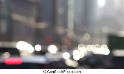 Steam of cars on the street of the big city, out of focus