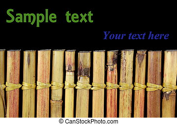 Bamboo and text space on black background