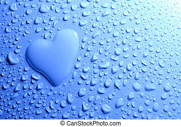 Water drops and heart shape on blue background