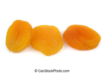 Sun dried apricots on white background.