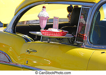 Old Car - Old yellow car with food tray and fake food to...