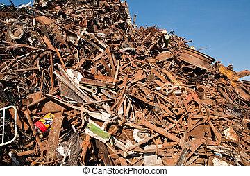 scrap and junk pile - scrap metal, plastic and blue sky