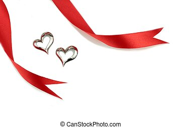 Red ribbon and hearted pattern isolated on white.