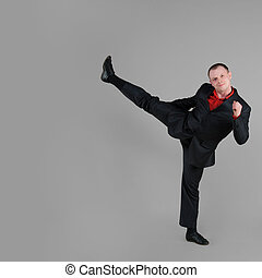 Businessman demonstrates a high kick