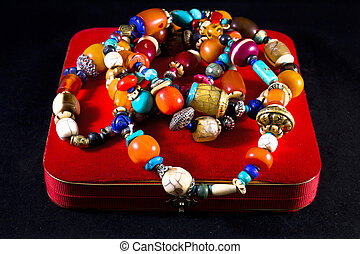 Jewelry box with necklace of precious stones