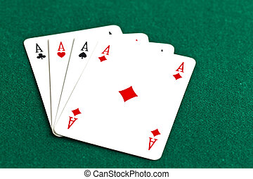 Poker of aces - Playing cards on a green background. Poker...