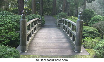 Wood Bridge in a garden - Footpath and bridge in the...