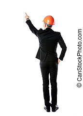 Back view portrait of a businessman in protective helmet...