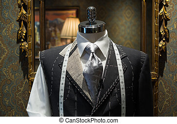 Unfinished jacket at a tailor shop - Unfinished gray jacket...