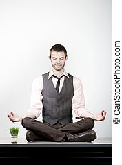 Handsome Young Businessman Meditating on Desk - Handsome...