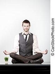 Handsome Young Businessman Meditating on Desk - Handsome...