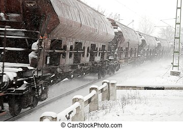 Train snow - Freight train passing by in the snow with...