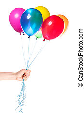 human hand gives flying balloons isolated Holiday background...