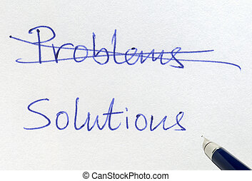 Crossing out problems and writing solutions.