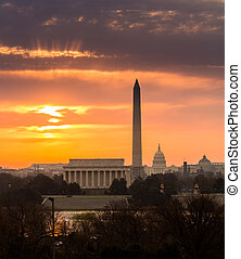 Fiery sunrise over monuments of Washington - Bright orange...