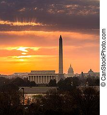 Fiery sunrise over monuments of Washington - Bright orange...