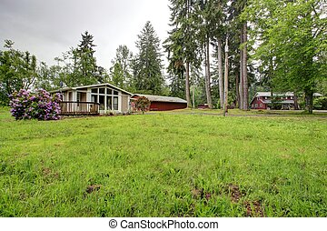 House on farm land - One story house with wooden deck, glass...