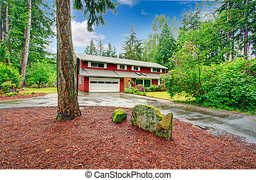 Red clapboard siding house with white garage door, and white...