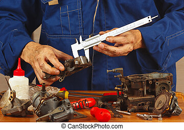 Repair of parts automotive engine in the workshop