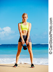 Attractive Athletic Woman Doing Kettle Bell Workout - Young...