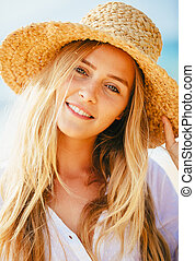 Portrait of beautiful blond girl on the beach - Fashion...