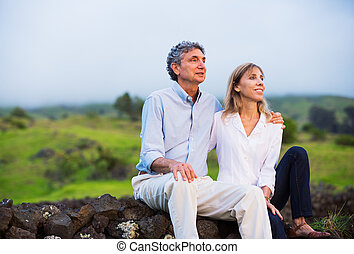 Mature middle age couple in love watching the sunset