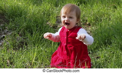 Dancing old child in nature - Year-old child sitting on a...