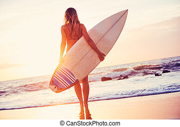 Surfer girl on the beach at sunset - Beautiful sexy surfer...