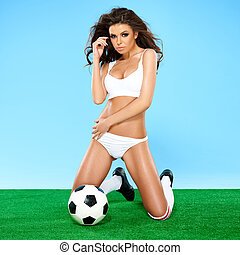 Beautiful busty female soccer player in white sport lingerie...