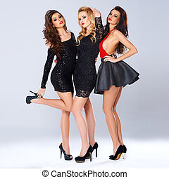 Three sexy elegant women in black evening wear - Three sexy...