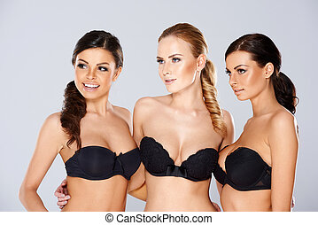 Three beautiful women modeling black lingerie - Three...