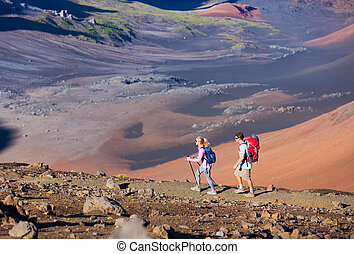 Hikers enjoying walk on amazing mountain trail. Backpacking...