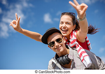 smiling teenagers in sunglasses having fun outside - summer...