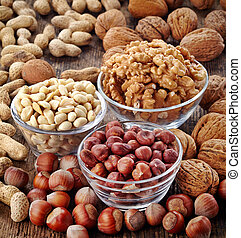 various kinds of nuts on wooden table