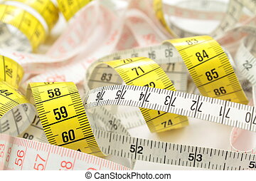 Various tape measure as background