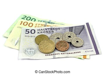 Danish kroner, coins and banknotes on white background.